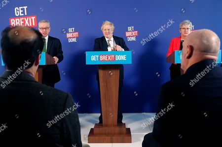 Chancellor of the Duchy of Lancaster Michael Gove, left, speaks during a media conference with Britain's Prime Minister Boris Johnson, center, and ex-Labour minister Gisela Stuart, in London, . Britain goes to the polls on Dec. 12