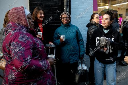 Stock Picture of Lena Headey pours hot drinks for people queuing at the official opening of the Choose Love store in Covent Garden