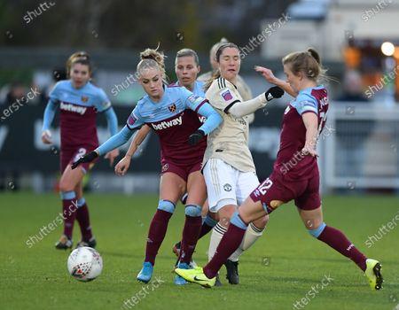 Jane Goldman of Manchester United Women battles for the ball with Alisha Lehmann of West Ham Women