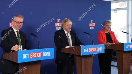 Britain's Prime Minister and Conservative leader Boris Johnson (C), Chancellor of the Duchy of Lancaster Michael Gove (L) and Chair of Vote Leave Gisela Stuart (R) take part in a press conference about Brexit and the general election in London, Britain, 29 November 2019.