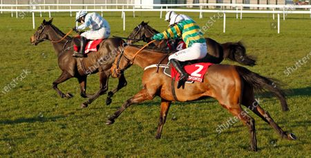 CHAMP (right, Barry Geraghty) catches BLACK OP (left) to win The Ladbrokes Novices Chase Newbury