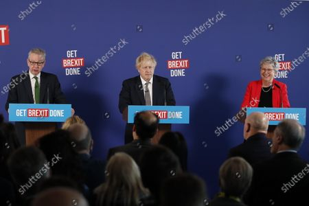 Prime Minister Boris Johnson answers questions at a press conference in London with Michael Gove and former Labour MP Gisela Stuart.