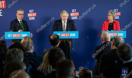 Stock Photo of Prime Minister Boris Johnson answers questions at a press conference in London with Michael Gove (L) and former Labour MP Gisela Stuart