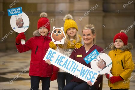 Stock Image of NHS 24 Nurse Lauren Kennedy and her three children, Eva, James and Callum