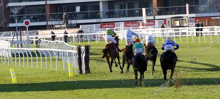 Stock Image of Champ and Barry Geraghty just squeeze through the rail to win the Ladbrokes Novices' Chase at Newbury.