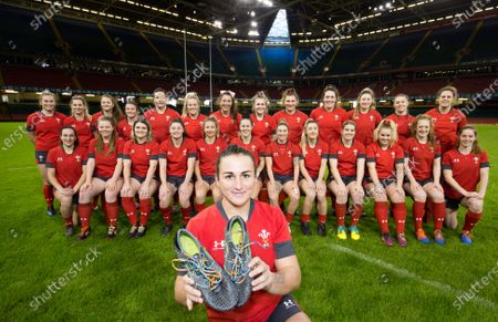 Wales Women captain Siwan Lillicrap with rainbow laces in her boots with the squad at the squad photocall at the Principality Stadium ahead of their match against the Barbarians