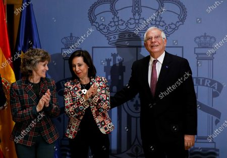 Acting Spanish Foreign Affairs Minister Josep Borrell (R) is applauded by his substitute, acting Defense Minister Margarita Robles (2-L), and acting Health Minister, Maria Luisa Carcedo, during a farewell ceremony at the Foreign Affairs Ministry, in Madrid, Spain, 29 November 2019. Borrell is to be the next High Representative of the EU for Foreign Affairs and Security Policy, and Robles will be the Defense and Foreign Affairs Minister from next 01 December.