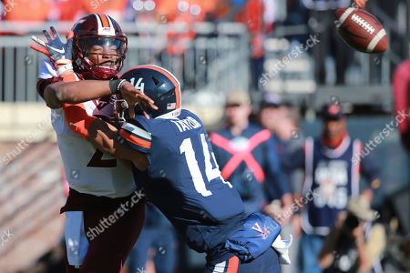 Hendon Hooker, Noah Taylor. Virginia Tech quarterback Hendon Hooker (2) is hit by Virginia linebacker Noah Taylor (14) as he throws the ball during the first half of an NCAA college football game between Virginia Tech and Virginia in Charlottesville, Va