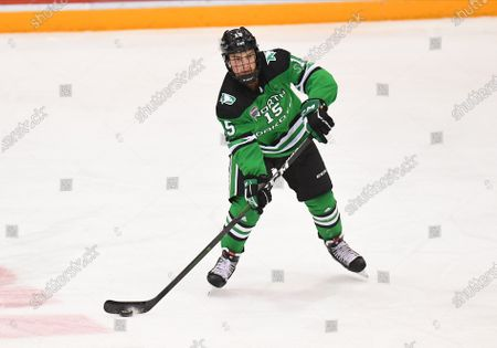 North Dakota Fighting Hawk defenseman Ethan Frisch makes a pass during a NCAA men's college hockey game between the University of North Dakota Fighting Hawks and the Minnesota Golden Gophers at 3M Arena at Mariucci in Minneapolis, MN. UND defeated UM 9-3