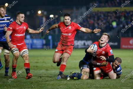 Nick Tompkins of Saracens is tackled by Jamie Roberts of Bath