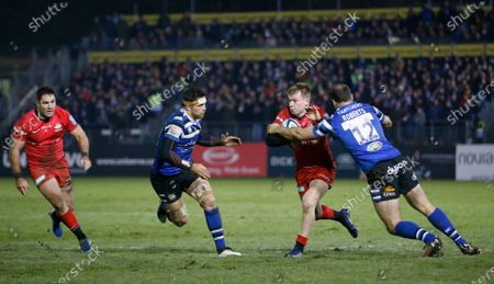 Nick Tompkins of Bath is tackled by Jamie Roberts of Bath