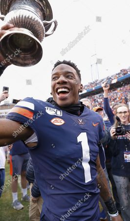 Virginia Cavaliers CB #1 Nick Grant hoists the Commonwealth Cup after a NCAA football game between the University of Virginia Cavaliers and the Virginia Tech Hokies at Scott Stadium in Charlottesville, Virginia