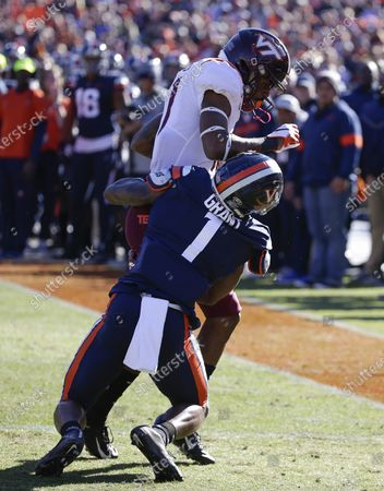 Virginia Tech Hokies WR #11 Tre Turner is driven out of bounds by Virginia Cavaliers CB #1 Nick Grant during NCAA football game between the University of Virginia Cavaliers and the Virginia Tech Hokies at Scott Stadium in Charlottesville, Virginia