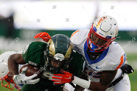 R m. Boise State cornerback Tyric LeBeauf, right, tackles Colorado State wide receiver Warren Jackson after he caught a pass in the second half of an NCAA college football game, in Fort Collins, Colo. Boise State won 31-24