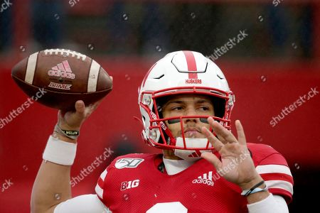 Nebraska quarterback Adrian Martinez (2) warms up before an NCAA college football game against Iowa in Lincoln, Neb