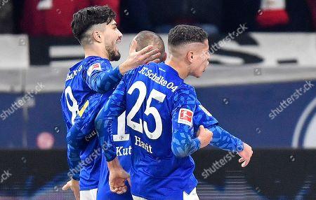 Schalke's Suat Serdar, left, celebrates his goal with Schalke's Ahmed Kutucu and Schalke's Amine Harit during the German Bundesliga soccer match between FC Schalke 04 and Union Berlin in Gelsenkirchen, Germany