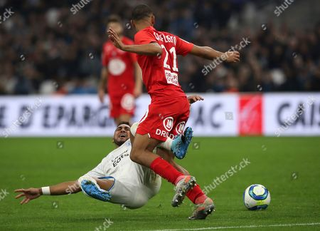 Marseille's Dimitri Payet, left, and Brest's Jean-Charles Castellettto challenge for the ball during the French League One soccer match between Marseille and Brest at the Velodrome stadium in Marseille, southern France