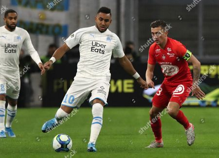Marseille's Dimitri Payet, centre, and Brest's Mathias Autret challenge for the ball during the French League One soccer match between Marseille and Brest at the Velodrome stadium in Marseille, southern France