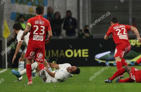 Marseille's Dimitri Payet lies on the pitch in pain during the French League One soccer match between Marseille and Brest at the Velodrome stadium in Marseille, southern France