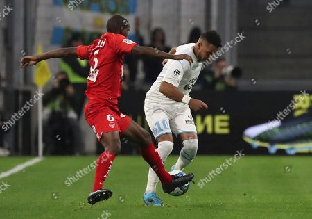 Brest's Ibrahima Diallo, left, and Marseille's Dimitri Payet challenge for the ball during the French League One soccer match between Marseille and Brest at the Velodrome stadium in Marseille, southern France