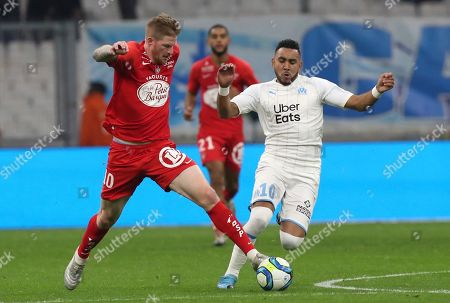 Brest's Gaetan Charbonnier, left, and Marseille's Dimitri Payet challenge for the ball during the French League One soccer match between Marseille and Brest at the Velodrome stadium in Marseille, southern France