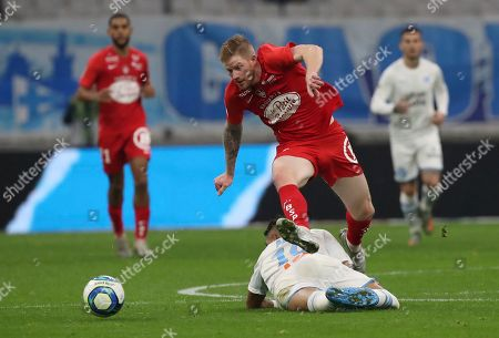 Brest's Gaetan Charbonnier, atop, and Marseille's Dimitri Payet challenge for the ball during the French League One soccer match between Marseille and Brest at the Velodrome stadium in Marseille, southern France