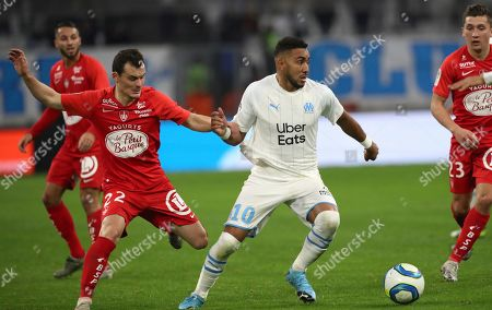 Brest's Julien Faussurier, left, and Marseille's Dimitri Payet challenge for the ball during the French League One soccer match between Marseille and Brest at the Velodrome stadium in Marseille, southern France