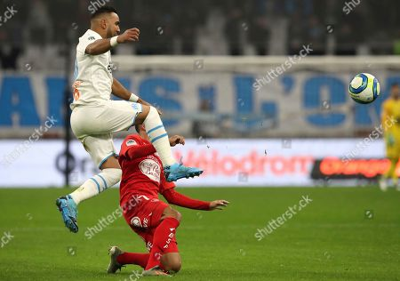 Marseille's Dimitri Payet, left, and Brest's Haris Belkebla challenge for the ball during the French League One soccer match between Marseille and Brest at the Velodrome stadium in Marseille, southern France