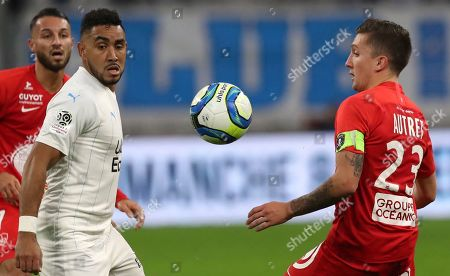 Marseille's Dimitri Payet, second left, and Brest's Mathias Autret challenge for the ball during the French League One soccer match between Marseille and Brest at the Velodrome stadium in Marseille, southern France