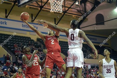 Maryland guard Aaron Wiggins (2) goes up for a shot in front of Harvard forward Chris Lewis (0) during the first half of an NCAA college basketball game, in Lake Buena Vista, Fla
