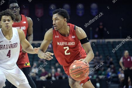 Maryland guard Aaron Wiggins (2) drives to the basket in front of Harvard forward Chris Ledlum (4) during the second half of an NCAA college basketball game, in Lake Buena Vista, Fla