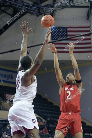Maryland guard Aaron Wiggins (2) goes up for a shot in front of Harvard forward Chris Lewis (0) during the second half of an NCAA college basketball game, in Lake Buena Vista, Fla