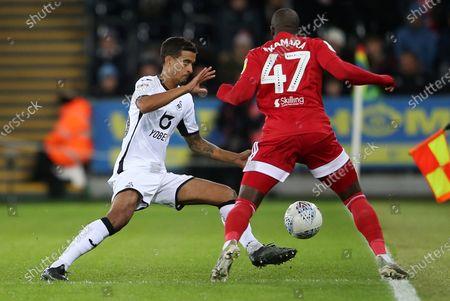 Aboubakar Kamara of Fulham is tackled by Kyle Naughton of Swansea City.