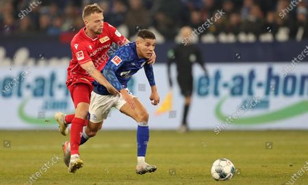Union's Marvin Friedrich in action with Schalke's Amine Harit during the German Bundesliga soccer match between FC Schalke 04 and FC Union Berlin in Gelsenkirchen, Germany, 29 November 2019.