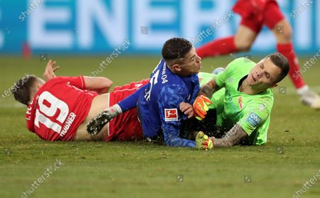Union's Florian Huebner (L) and Union's goalkeeper Rafal Gikiewicz (R) in action with Schalke's Amine Harit (C) during the German Bundesliga soccer match between FC Schalke 04 and FC Union Berlin in Gelsenkirchen, Germany, 29 November 2019.