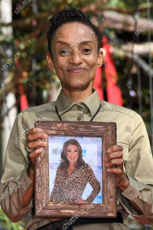 Stock Photo of Adele Roberts is evicted from camp, holding her photo of Jane McDonald