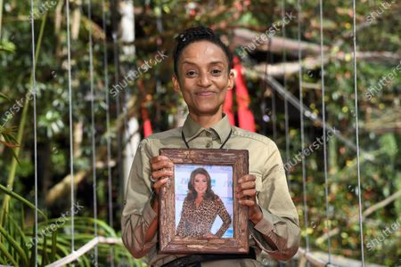 Adele Roberts is evicted from camp, holding her photo of Jane McDonald