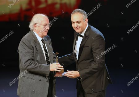 Italian Director of photography Vittorio Storaro receives an award from Festival's director Mohamed Hefzy during the closing ceremony of the 41st Cairo International Film Festival (CIFF), in Cairo, Egypt, 29 November 2019.