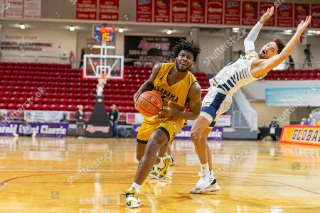 Chattanooga guard Jonathan Scott (1) draws a foul as Alabama State guard Jeremy Hamilton (4) drives to the basket during an NCAA college basketball game at the Emerald Coast Classic in Niceville, Fla., . Chattanooga defeated Alabama State 74-56