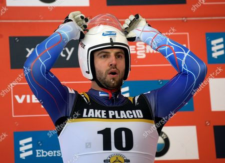 Chris Mazdzer, of the United States, prepares for the start of a qualifying run for the men's World Cup luge race, in Lake Placid, N.Y. Competition begins on Saturday