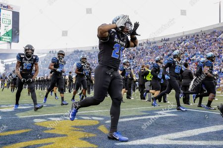Stock Photo of Memphis running back Timothy Taylor (21) takes the field before an NCAA college football game against Cincinnati, in Memphis, Tenn