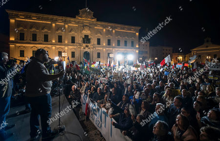 Manuel Delia from Occupy Justice addresses the crowd during a protest outside the office of the Prime Minster of Malta by civil groups Occupy Justice and Republica in Valletta, calling for the resignation of Malta Prime Minister Joseph Muscat after his chief of staff Keith Scembri was arrested and questioned regarding the murder of slain journalist Daphne Caruana Galizia. Muscat said Friday that police found no grounds to hold Keith Schembri, his former chief of staff in custody