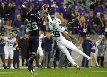 TCU safety Vernon Scott (26) tries to grab a pass intended for West Virginia wide receiver Isaiah Esdale (88) in an NCAA college football game, in Fort Worth, Texas