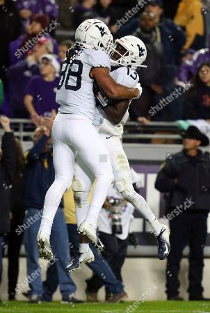 West Virginia wide receiver Isaiah Esdale (88) and wide receiver Sam James (13) celebrate a fourth quarter touchdown by Esdale against TCU in an NCAA college football game, in Fort Worth, Texas