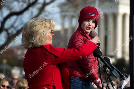 """Actress and activist Jane Fonda holds the microphone for Iain Armitage an 11-year-old actor, during the """"Fire Drill Fridays"""" rally, calling on Congress for action to address climate change, on Capitol Hill in Washington, . A half-century after throwing her attention-getting celebrity status into Vietnam War protests, Fonda is now doing the same in a U.S. climate movement where the average age is 18"""