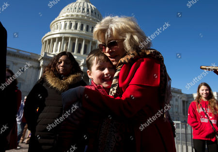 """Actress and activist Jane Fonda gives a hug to Iain Armitage, an 11-year-old actor, during the """"Fire Drill Fridays"""" protest, calling on Congress for action to address climate change, on Capitol Hill in Washington, . A half-century after throwing her attention-getting celebrity status into Vietnam War protests, Fonda is now doing the same in a U.S. climate movement where the average age is 18"""