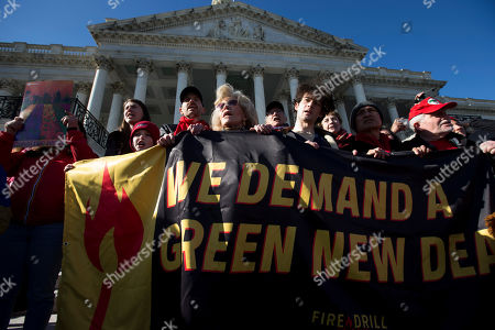 """Actress and activist Jane Fonda accompanied by Iain Armitage, left, an 11-year-old actor, a long with others, protest during the """"Fire Drill Fridays"""" protest, calling on Congress for action to address climate change on Capitol Hill in Washington, . A half-century after throwing her attention-getting celebrity status into Vietnam War protests, Fonda is now doing the same in a U.S. climate movement where the average age is 18"""