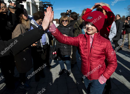 """Iain Armitage an 11-year-old actor, gives a hi five to supporters, during the """"Fire Drill Fridays"""" protest, calling on Congress for action to address climate change, on Capitol Hill in Washington"""