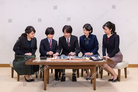 Akishino, Kiko, Mako, Kako, Hisahito. In this Nov.15, 2019, photo provided by the Imperial Household Agency of Japan; Japan's Crown Prince Akishino, center, speaks with his wife Crown Princess Kiko, second right, and their children, Princess Mako, left, Princess Kako, right, and Prince Hisahito, second left, at their residence in Tokyo. Prince Akishino, Emperor Naruhito's brother, celebrated his 54th birthday on Nov. 30