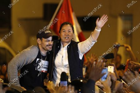 Peruvian politician Keiko Fujimori (C) embraces her husband Mark Vitto (L) as she leaves the jail where she was under preventive detention for almost thirteen months, in Lima, Peru, 29 November 2019. The daughter of former president Alberto Fujimori (1990-2000) will face the rest of the investigation that follows her in the case of Lava Jato corruption for alleged money laundering in the financing of her electoral campaigns, thanks to a controversial ruling by the Constitutional Court which annulled pretrial detention.